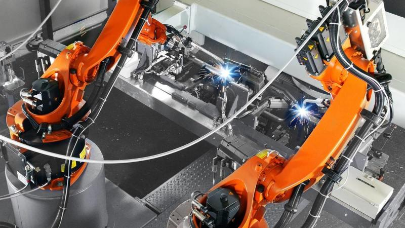 Integration of robotic laser welding, cutting, surfacing and hardening